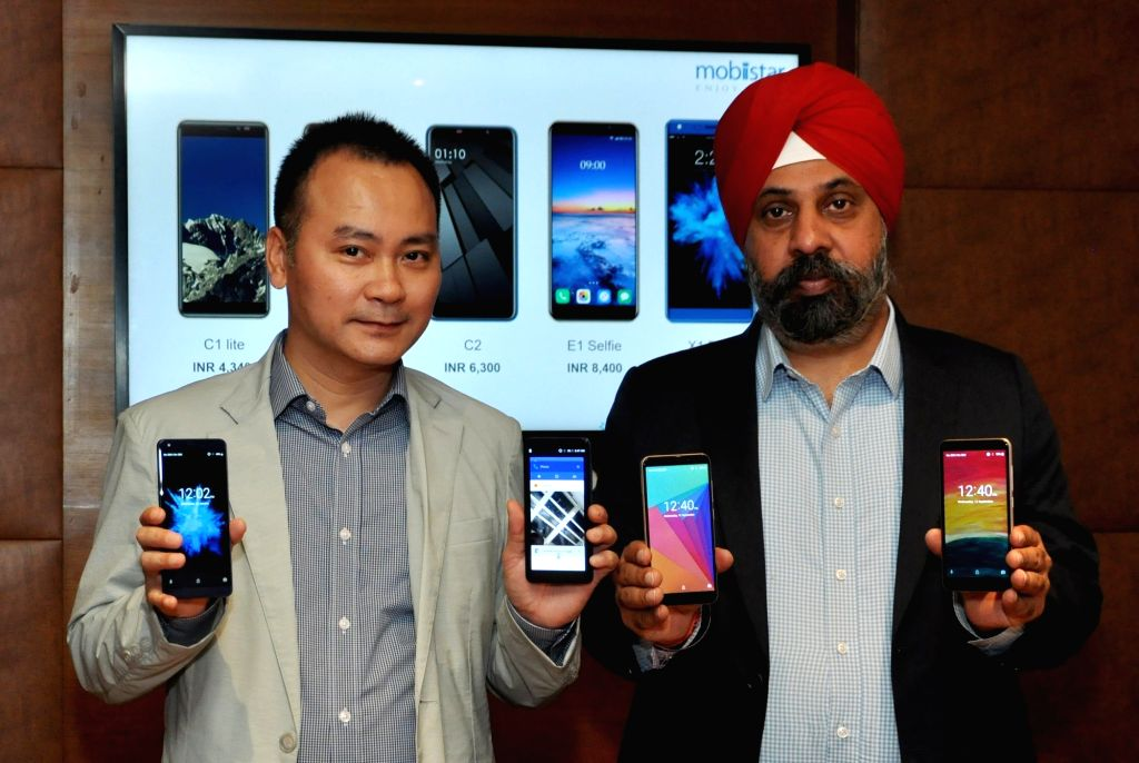 Mobiistar Co-founder and CEO Carl Ngo and Mobiistar India Vice President - Sales (North and East) Hardeep Singh Johar during the launch of C1 Lite, C1, C2, 'X1 Dual' and 'E1 Selfie' ... - Hardeep Singh Johar