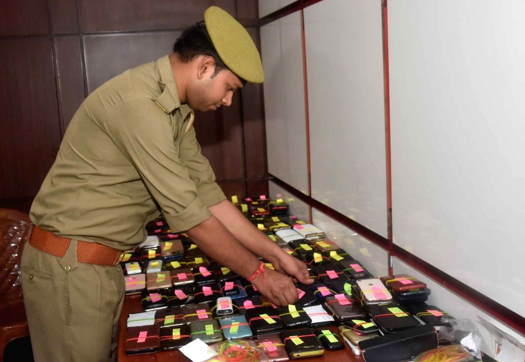 Mobile phones of ministers and officials deposited at a designated counter ahead of a review meeting to be chaired by Uttar Pradesh Chief Minister Yogi Adityanath with the Department of ... - Yogi Adityanath