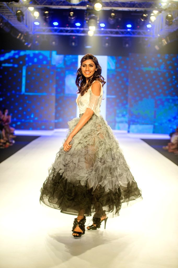 Model Apeksha Porwal walks the ramp showcasing designers Karl and Leo's creation on the second day of Bombay Times Fashion Week 2018, in Mumbai on March 31, 2018. - Apeksha Porwal