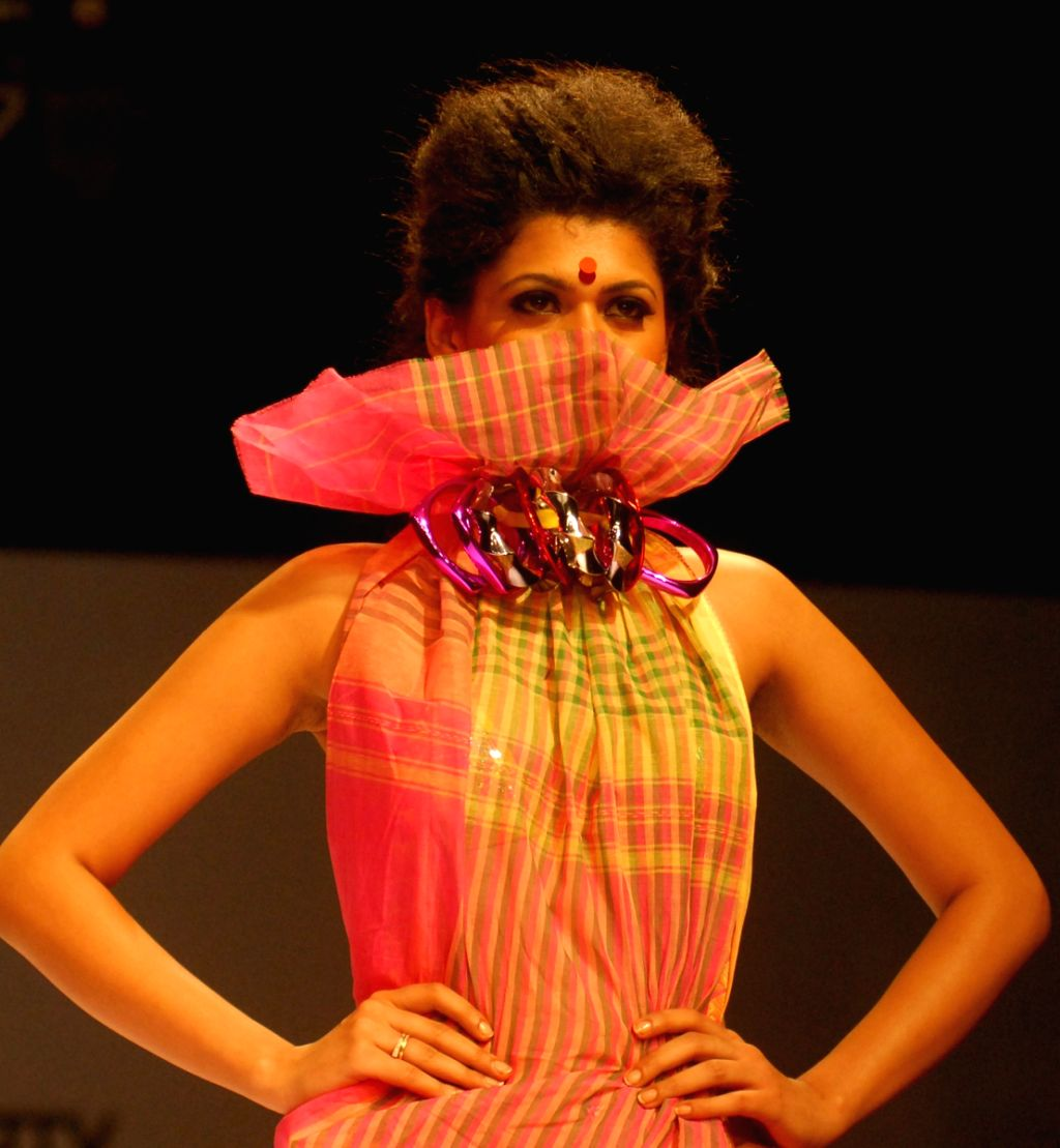 Model are at the ramp for weaves collection during the Kolkata Fashion Week on 3rd April 2009.