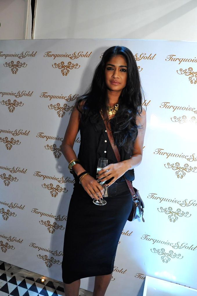 Model Carol Gracias during the launch of Turquoise & Gold store in Mumbai on April 16, 2014. - Carol Gracias