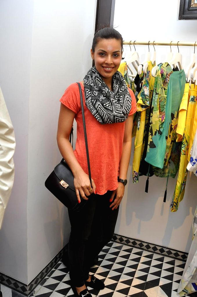 Model Deepti Gujra during the launch of Turquoise & Gold store in Mumbai on April 16, 2014. - Deepti Gujra