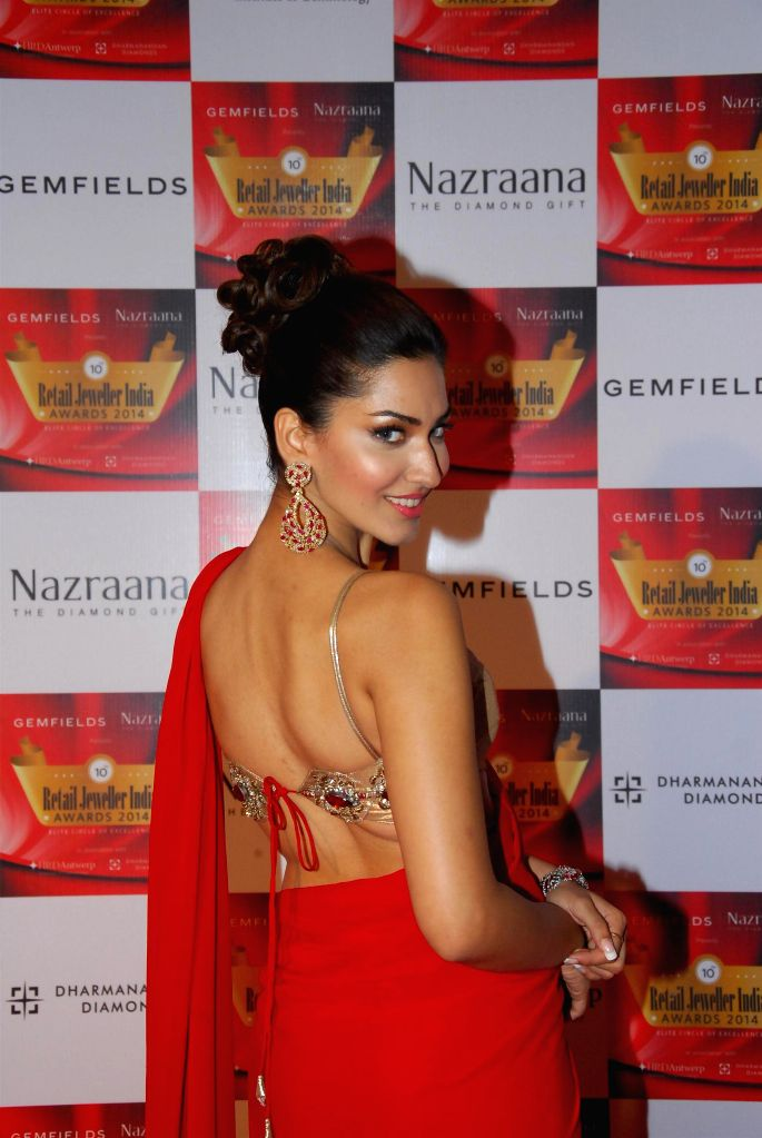 Model Jhataleka Malhotra during the 10th Annual Gemfields and Nazraana Retail Jeweller India Awards 2014 in Mumbai on July 19, 2014. (Photo : IANS) - Jhataleka Malhotra
