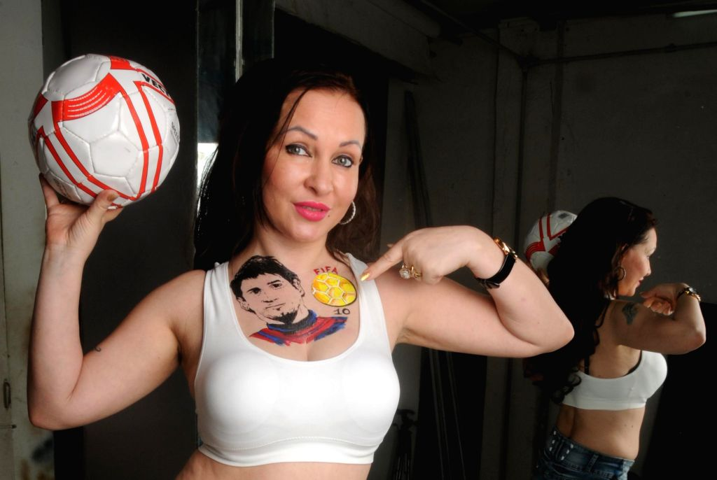 Model Nataliya Kozhenova a football enthusiast inked her favorite player Lionel Messi on her chest and cheering up for team for the ongoing FIFA Worldcup 2014 in Mumbai on July 9, 2014.
