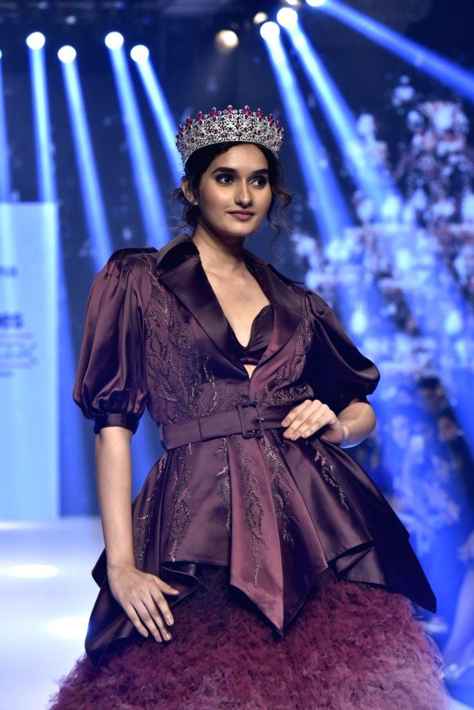 Model Nehal Chudasama showcases a creation of fashion designer Dheeraj Sharma at Bombay Times Fashion Week Spring/ Summer 2019 in Mumbai, on March 25, 2019. - Nehal Chudasama and Dheeraj Sharma
