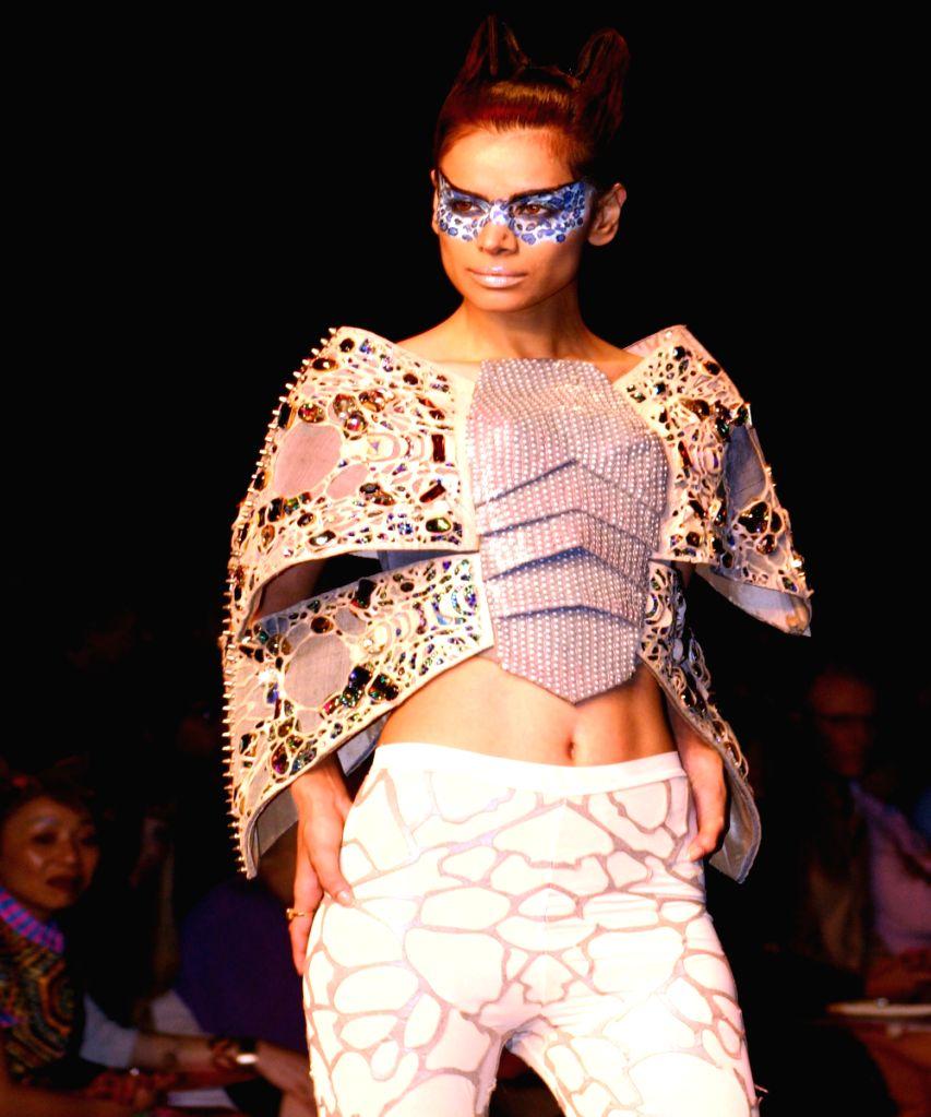 Model on the ramp for designer Manish Arora at Wills Lifestyle India Fashion Week in New Delhi on March 20. - Manish Arora