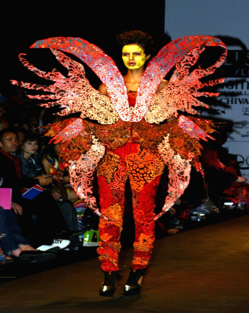 Model on the ramp for designer Manish Arora at Wills Lifestyle India Fashion Week in New Delhi on March 20. - Manish Arora