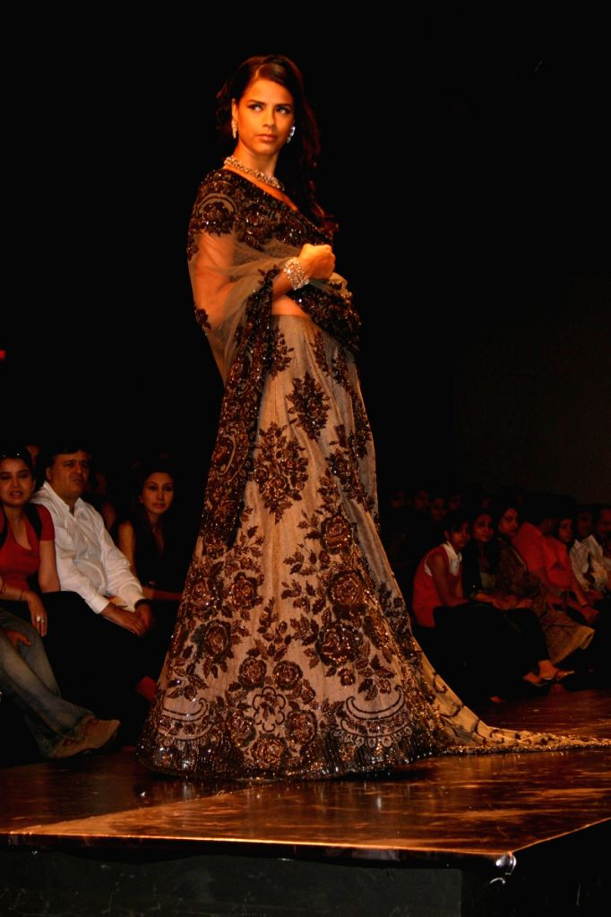 Model on the ramp for Designer Swapan Seema at WIFW in New Delhi on March 21.
