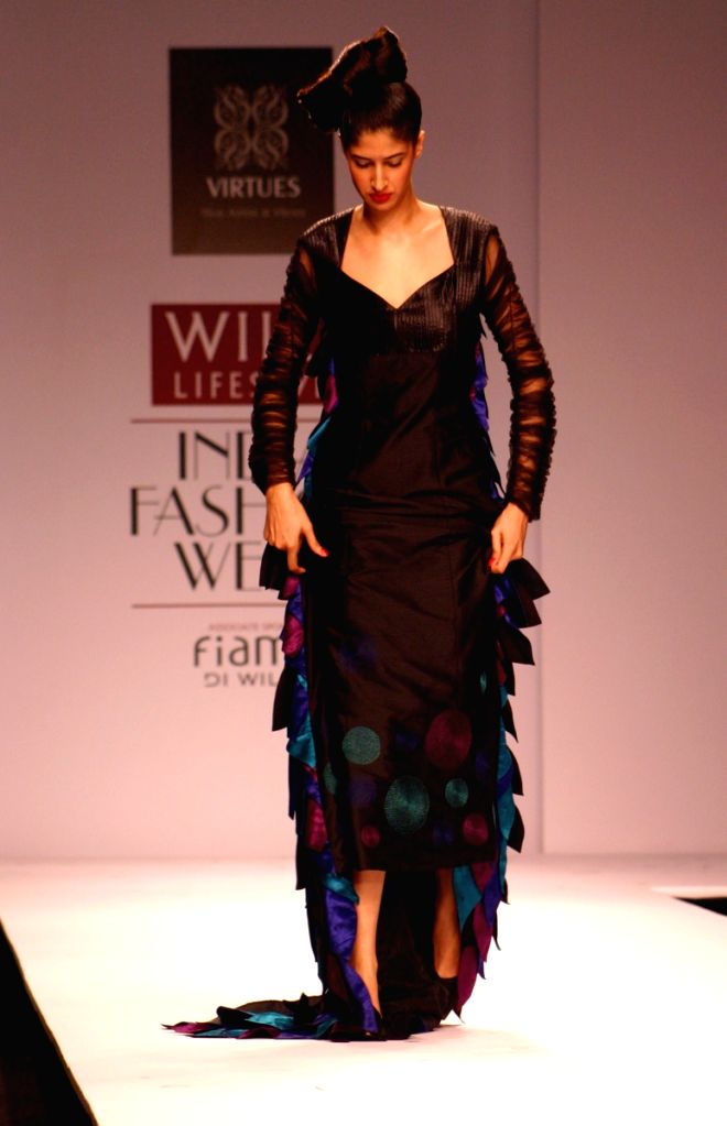 Model outfit got Stucked on the ramp during Ashish Viral and Vikrant show at Wills Lifestyle India Fashion Week in New Delhi on March 18.