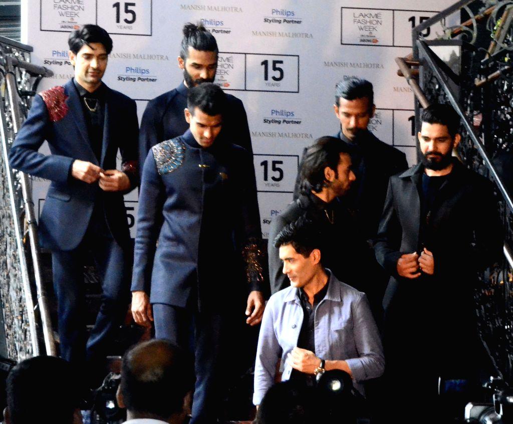 Models showcase the creations of Manish Malhotra during Lakme Fashion Week winter-festive 2015 in Mumbai, on Aug 17, 2015.