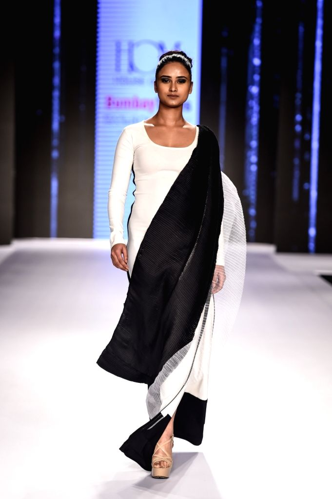Model Shraddha Shashidhar walks the ramp showcasing designer Reshma Merchant's creation on the second day of Bombay Times Fashion Week 2018, in Mumbai on March 31, 2018. - Shraddha Shashidhar