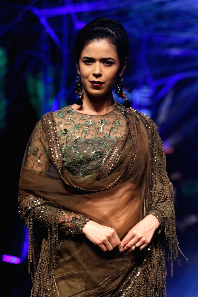Model Sucheta Sharma displays the creation of fashion designer Tarun Tahiliani during the Lakme Fashion Week Winter Festive 2016, in Mumbai, on Aug 23, 2016. - Sucheta Sharma