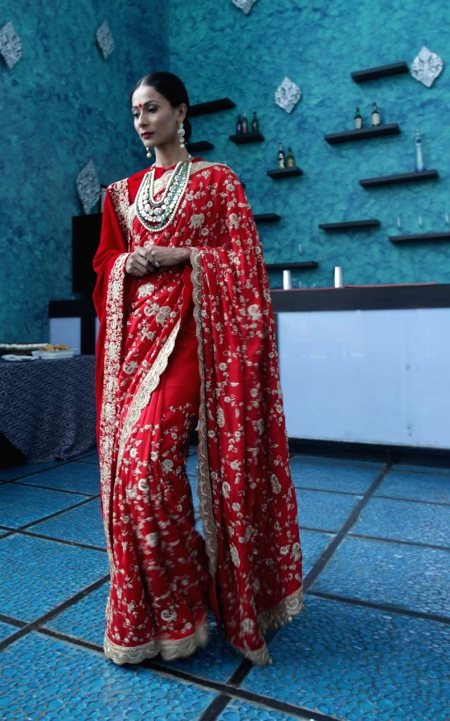 Model Ushoshi Sengupta showcase designer Saroj Jalan latest A/W collection to be featured in Lakme Fashion Week in Kolkata on Aug 19, 2016. - Ushoshi Sengupta