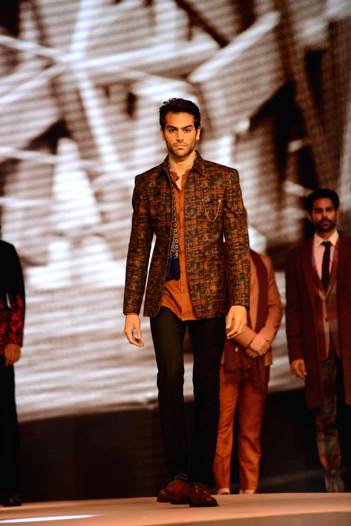 Model walks the ramp during the fashion show with a theme Raymond Khadi - A Story Re - Spun in Mumbai, on May 18, 2017.