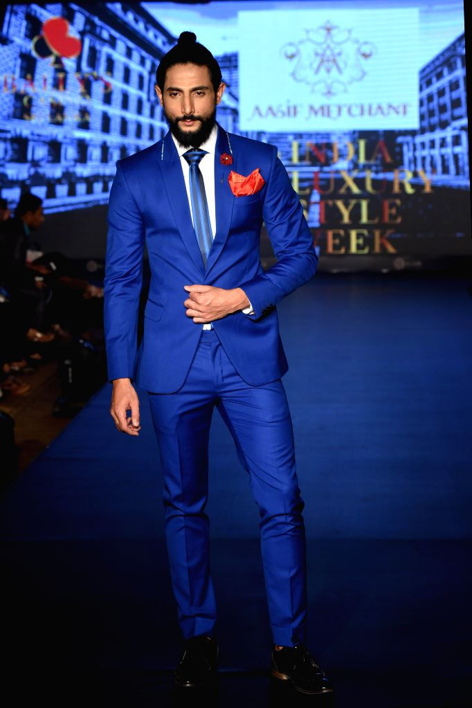 Model walks the ramp for Aasif Merchant during the lndia`s first Men`s Fashion Week - ILSW, in Bengaluru on 16 Aug 2015.