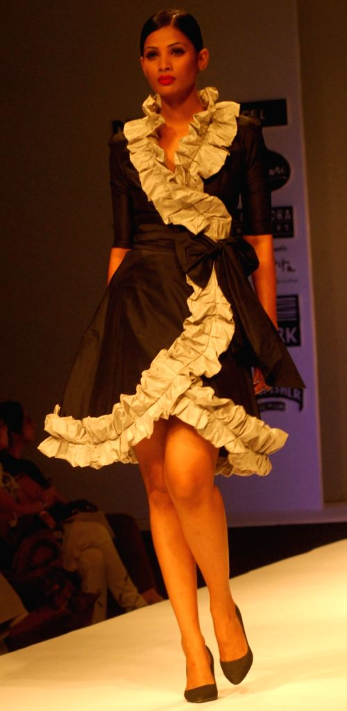 Model walks the runway for Designer Gauri and Nainika show during the Kolkata Fashion Week on 5th April 2009, India.
