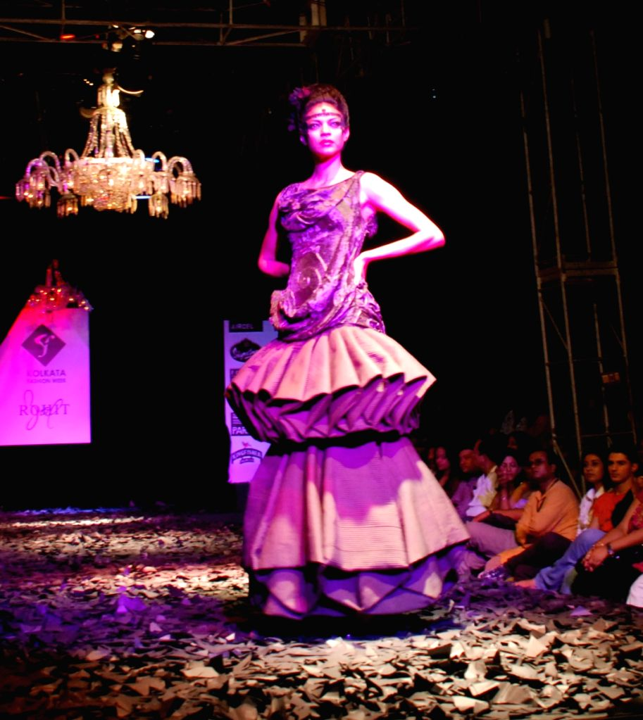 Model walks the runway for designer Rohit Bal show during the Kolkata Fashion Week on 5th April 2009, India.