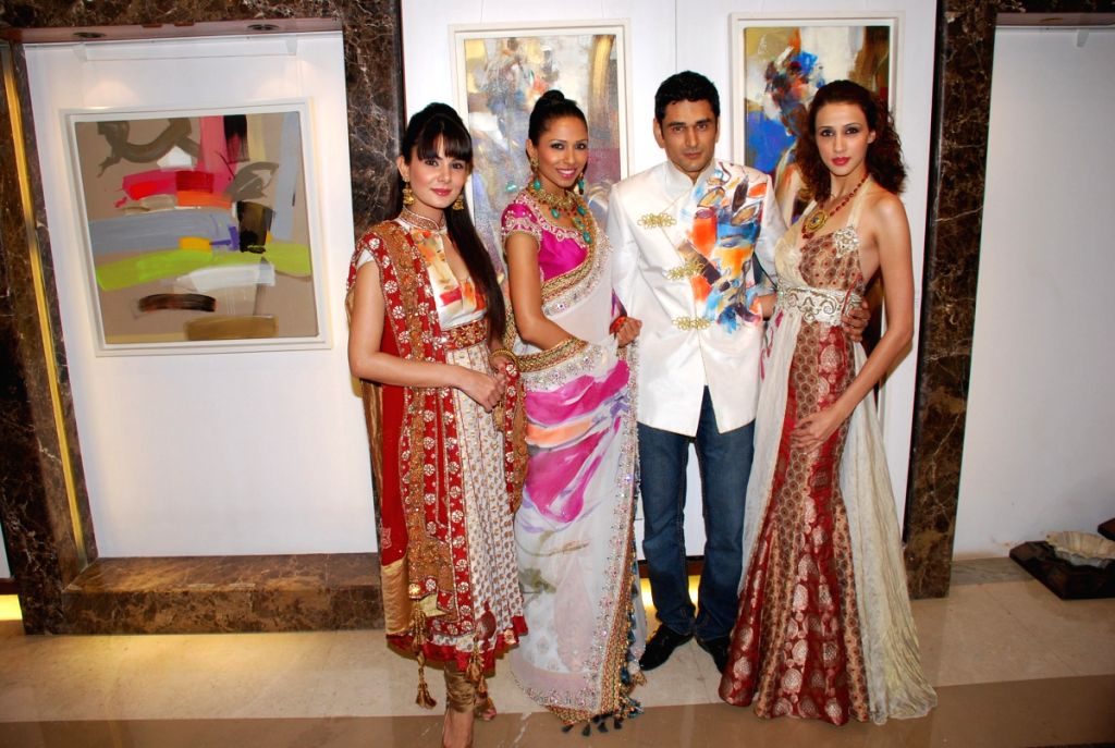 Models Achal Kumar, Candice Pinto and Alecia Raut posing for the shutterbugs at designer Priya Chintan's store for artist Niladri Paul.