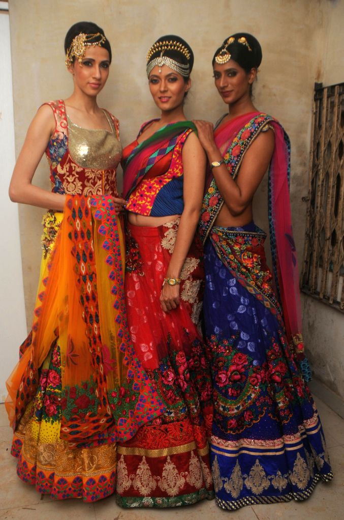 Models Alesia Raut, Shriya Kishore and sheela tiruchi during the preview of Rohit Verma`s newest collection `Vrindavan` presented this Janmashtami, in Mumbai on Aug 14, 2014.