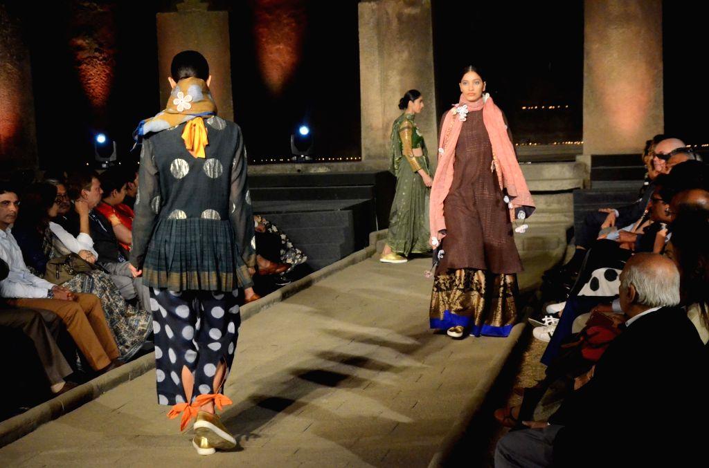 "Models at walk the ramp at ""Artisan Speak"" - a fashion show organised at Elephanta caves, in Maharashtra on Jan 28, 2019."