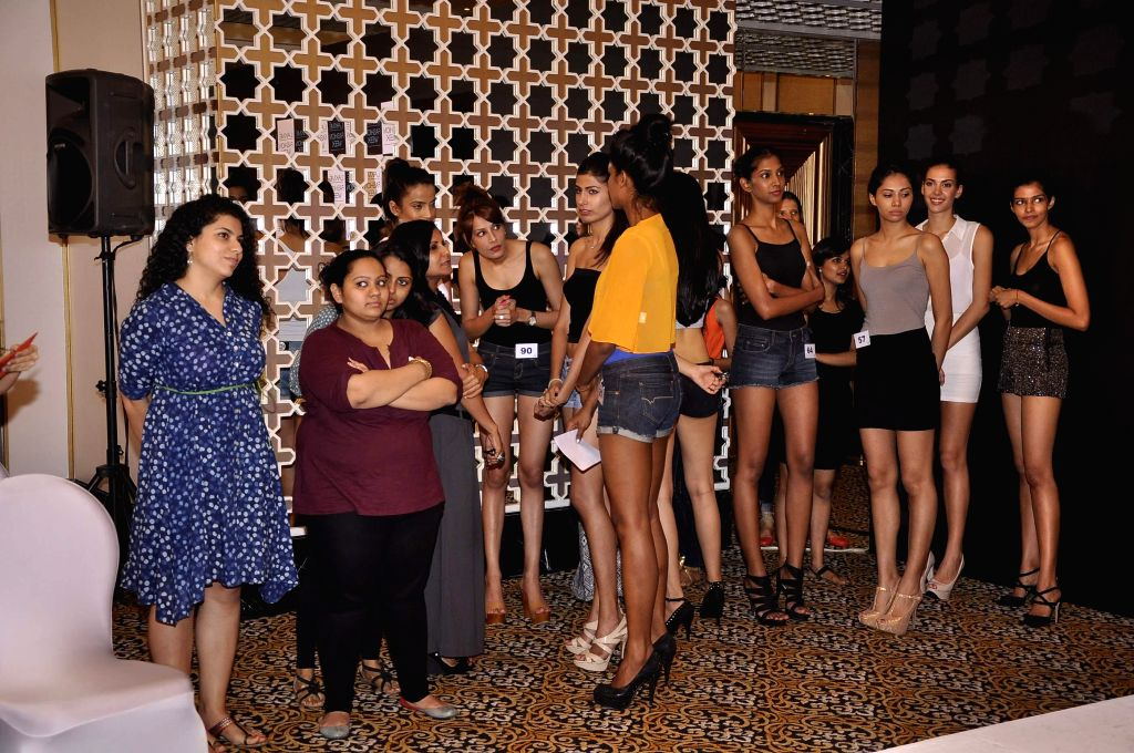 Models await their turn to audition for the Lakme Fashion Week, in Mumbai on July 3, 2014. The LFW Winter/Festive which is scheduled for August 22-24, 2014.