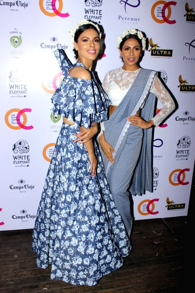 Models Candice Pinto and Dipti Gujral during the launch of fashion designer Mayyur Girotra`s exclusive pret line White Elephant in Mumbai, on May 30, 2017.