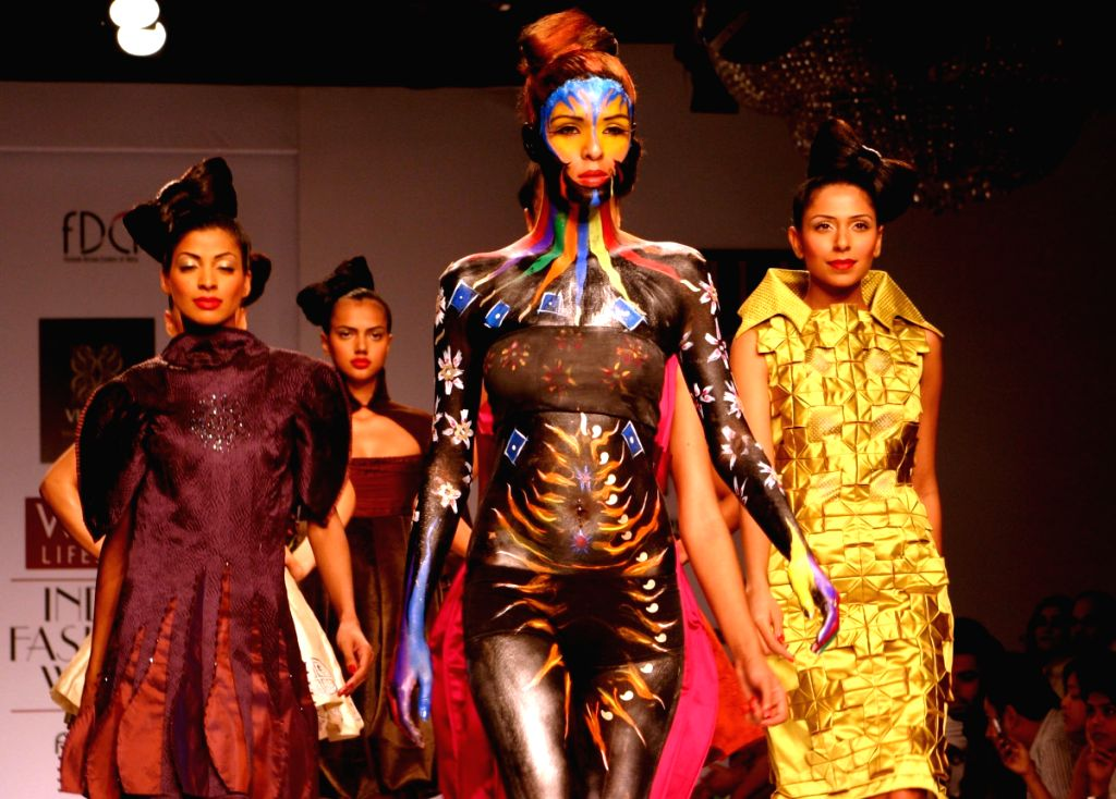 Models display creation by designer Ashish Viral and Vikrant at Wills Lifestyle India Fashion Week in New Delhi on March 18.
