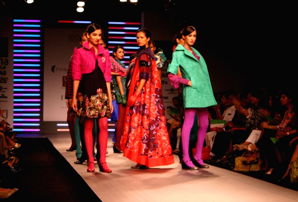 Models display creation by designers Pankaj and Nidhi at Wills Lifestyle India Fashion Week in New Delhi on March 19.