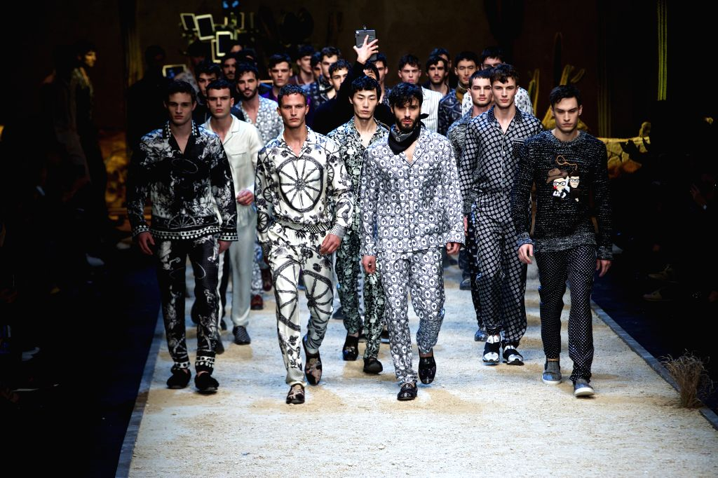 Models display creations as part of the Dolce & Gabbana men's Fall-Winter 2016-2017 show collection during Milan Fashion Week in Milan, Italy, on Jan. 16, 2016. ...