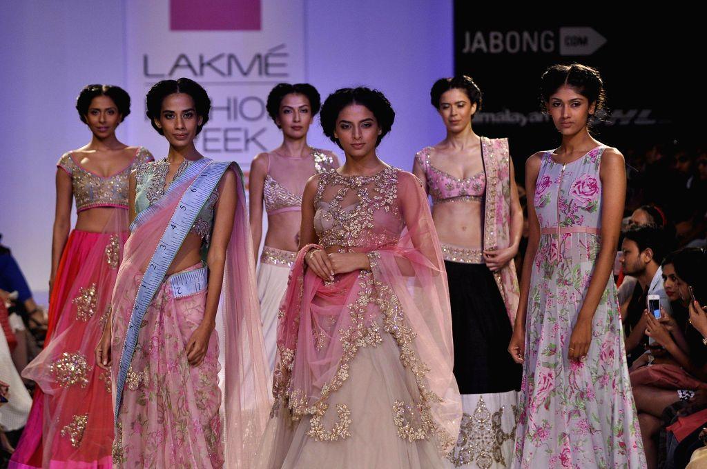 Models display the creation of fashion designer Anushree Reedy during the Lakme Fashion Week (LFW) Winter/ Festive 2014 in Mumbai, on Aug. 23, 2014.