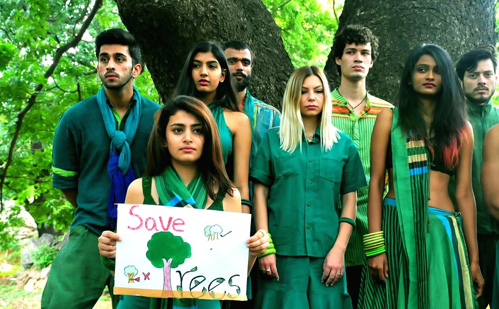Models during a programme organised to urge people to save trees in Bengaluru, on June 11, 2017.