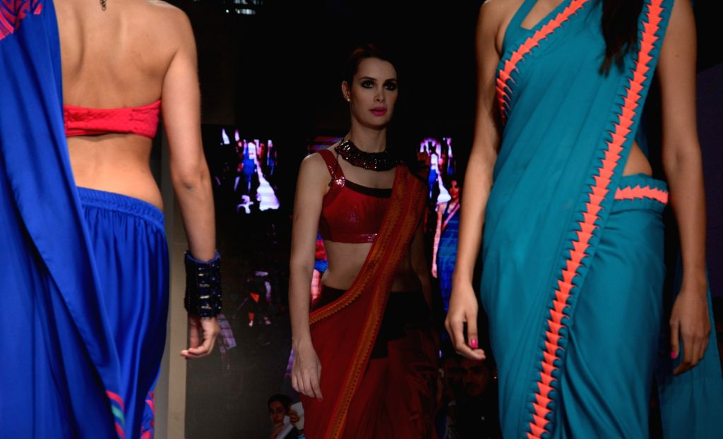 Models during India Resortwear Fashion Week (IRFW) in Mumbai on Dec.13, 2013.