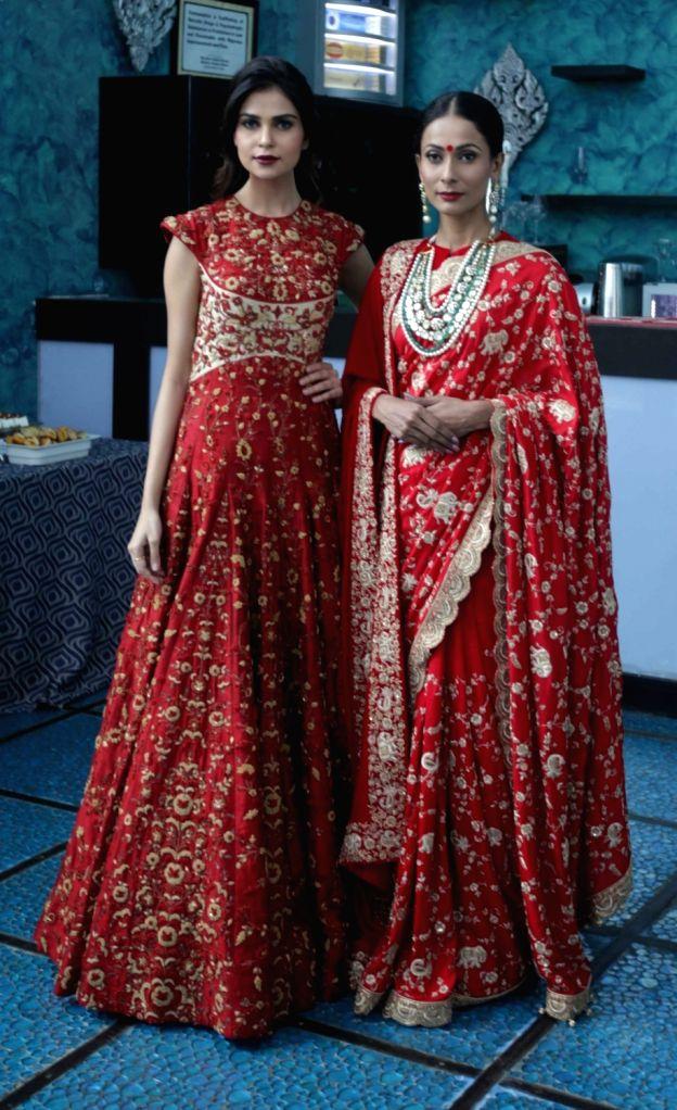 Models Lisha Sharma and Ushoshi Sengupta showcase designer Saroj Jalan latest A/W collection to be featured in Lakme Fashion Week in Kolkata on Aug 19, 2016. - Lisha Sharma