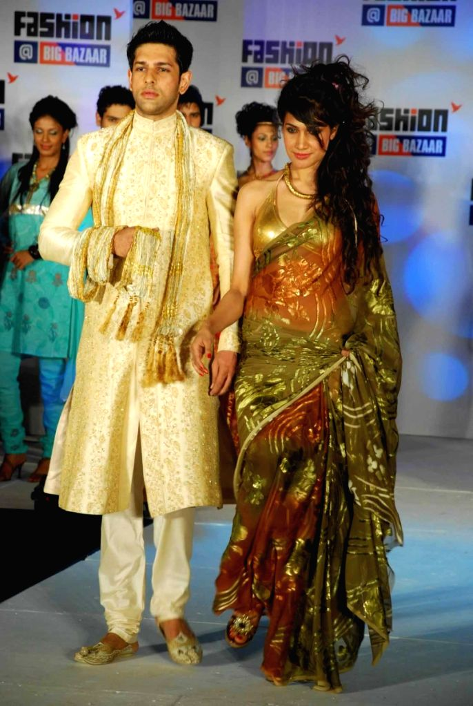 Models on the ramp at the promotional event of retail chain Big Bazaar.