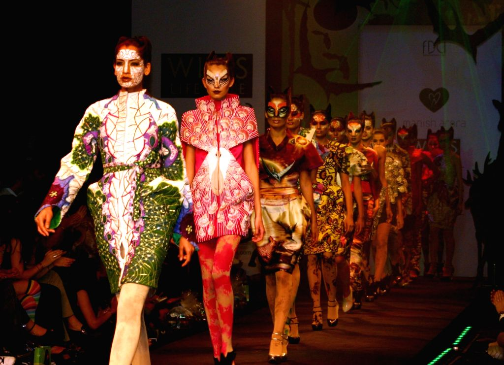 Models on the ramp for designer Manish Arora at Wills Lifestyle India Fashion Week in New Delhi on March 20. - Manish Arora