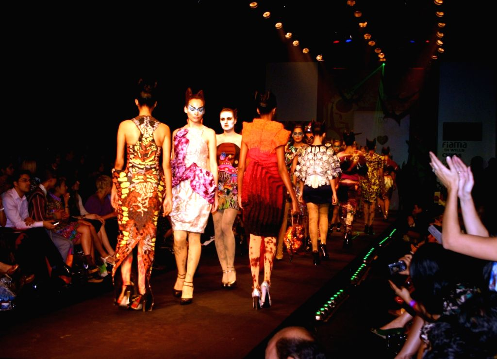 Models on the ramp for designer Manish Arora at Wills Lifestyle India Fashion Week in New Delhi on March 20. - Manish Arora