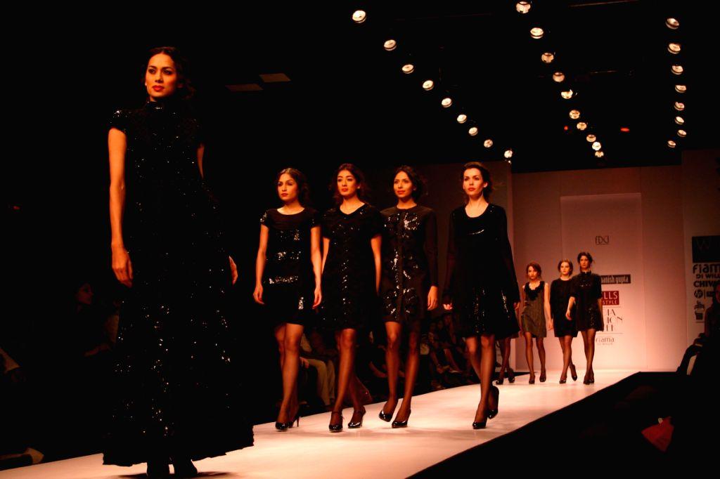 Models on the ramp for designer Manish Gupta at Wills Lifestyle India Fashion Week in New Delhi on March 20. - Manish Gupta