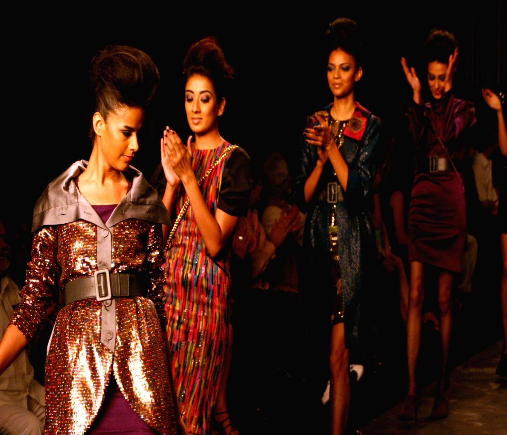 Models on the ramp for designer Namrata Joshipura at Wills Lifestyle India Fashion Week in New Delhi on March 20.