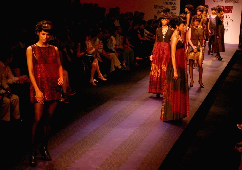 Models on the ramp for designer Nikkiee Mahajan at Wills Lifestyle India Fashion Week in New Delhi on March 20. - Nikkiee Mahajan