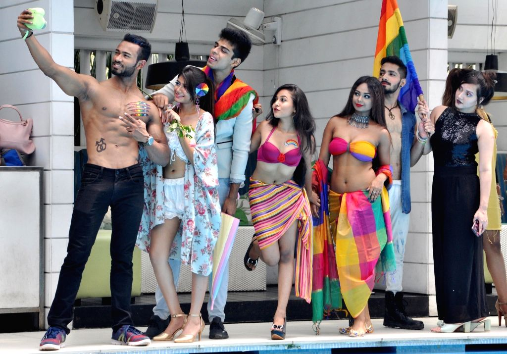 "Models pose for selfies during a photoshoot organised on the theme ""Rainbow – Colors of Pride"",  in Kolkata on Sep 12, 2018."