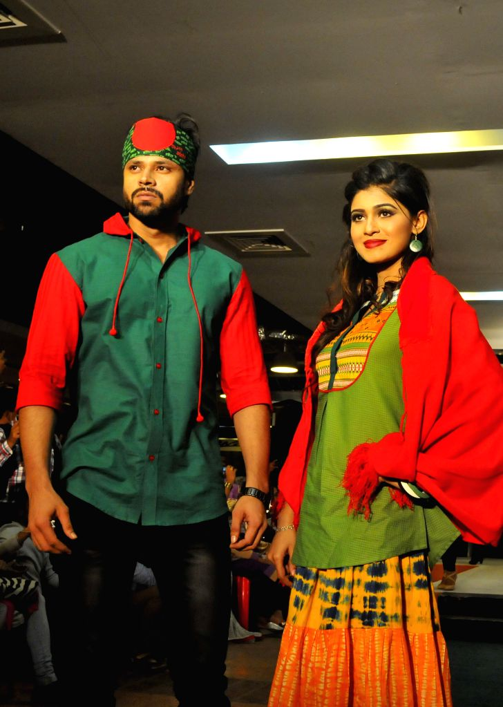 Models present Bangladeshi fabric designs during the Winter Fashion Show in Dhaka, Bangladesh, Dec. 3, 2015.