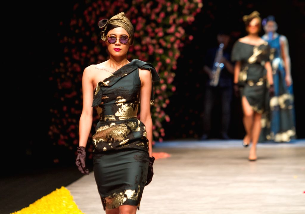 Models present collections by Vietnamese designer Phuong My during the first day of the Vietnam International Fashion Week 2015 in Ho Chi Minh City, ...