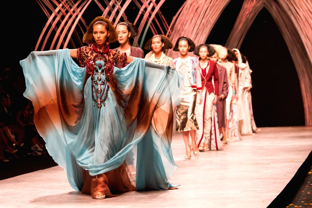 Models present collections of France designer Julien Fournie during the first day of the Vietnam International Fashion Week 2015 in Ho Chi Minh City, ...