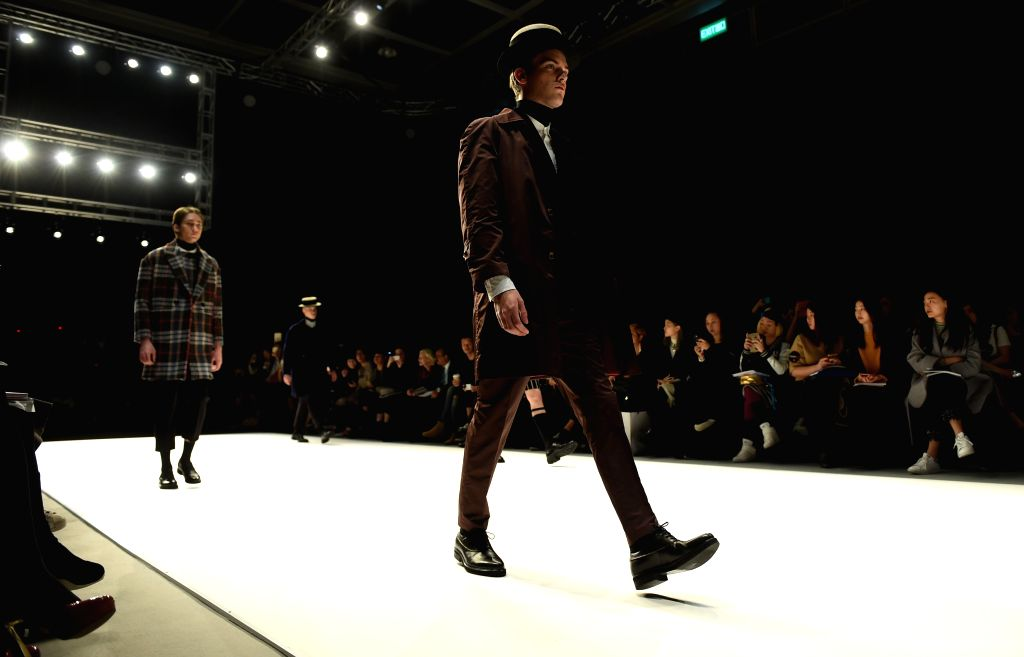 Models present creation during Hong Kong Fashion Week for Fall/Winter in south China's Hong Kong, Jan. 18, 2016. (Xinhua/Lui Siu Wai)