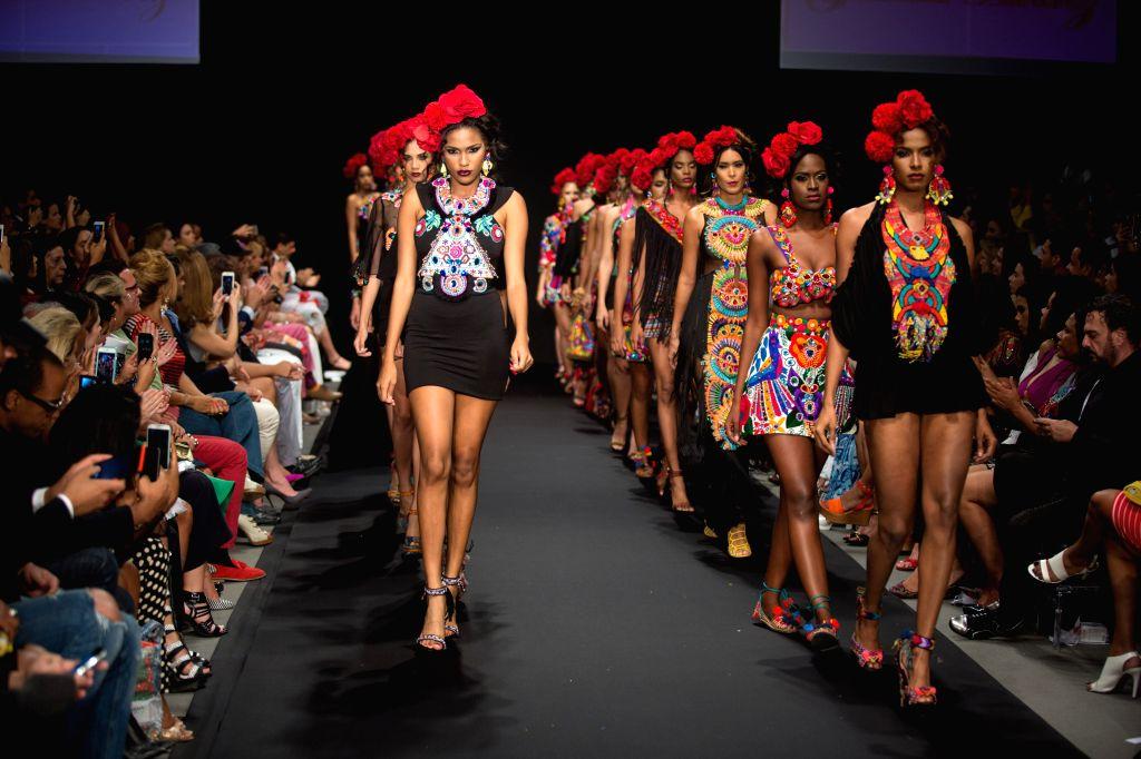 Models present creations by Dominican designers Giannina Azar and Gabriela Alvarez, during the fashion show Dominicana Moda 2015, in Santo Domingo, Dominican ...