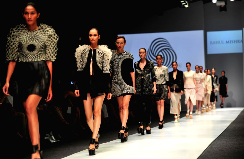 Models present creations by Indian designer Rahul Mishra during the first day of Jakarta Fashion Week in Jakarta, Indonesia, Oct. 24, 2015.