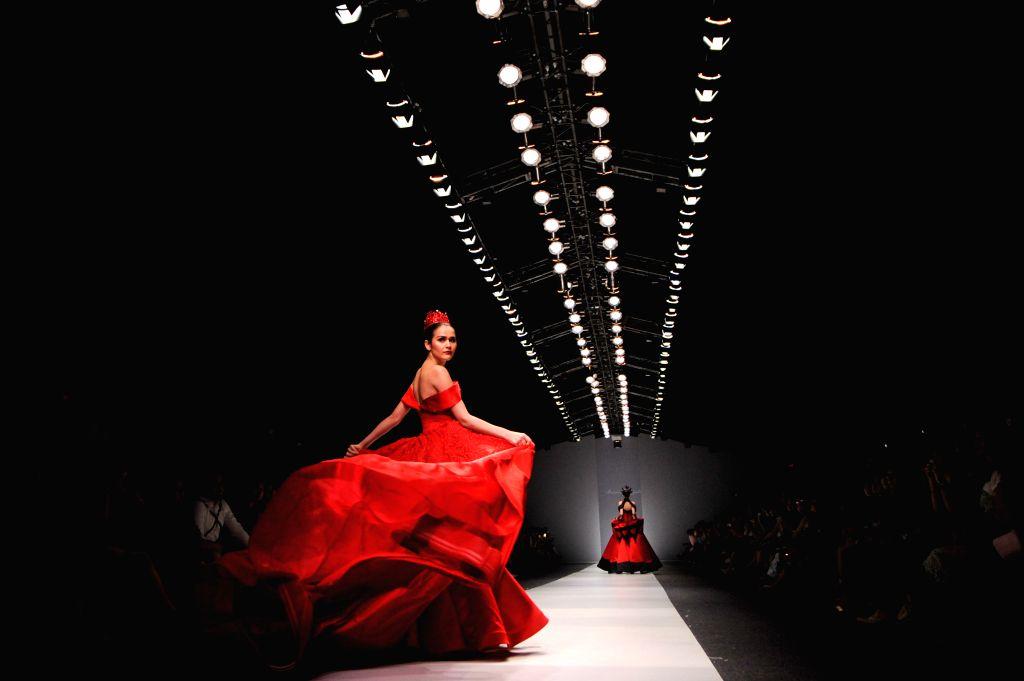 Models present creations by Indonesian designer Marcia Muljadi during Jakarta Fashion Week 2016 in Jakarta, Indonesia, Oct. 25, 2015.