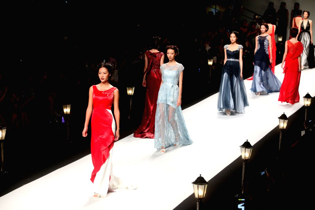Models present creations of brand Galatea Bridal during the Shanghai Fashion Week in east China's Shanghai, Oct. 17, 2015. About 50 fashion shows would be held ...
