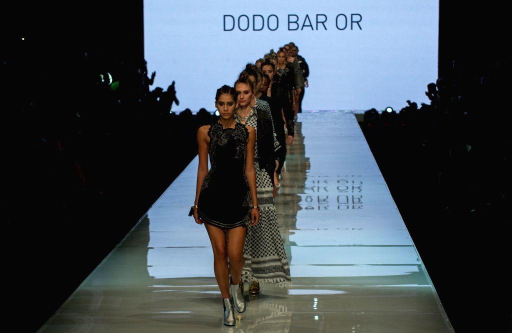 Models present creations of Dodo Bar Or during Gindi Tel Aviv Fashion Week in Tel Aviv, Israel, on Oct. 21, 2015. The four-day Gindi Tel Aviv Fashion Week ended ...