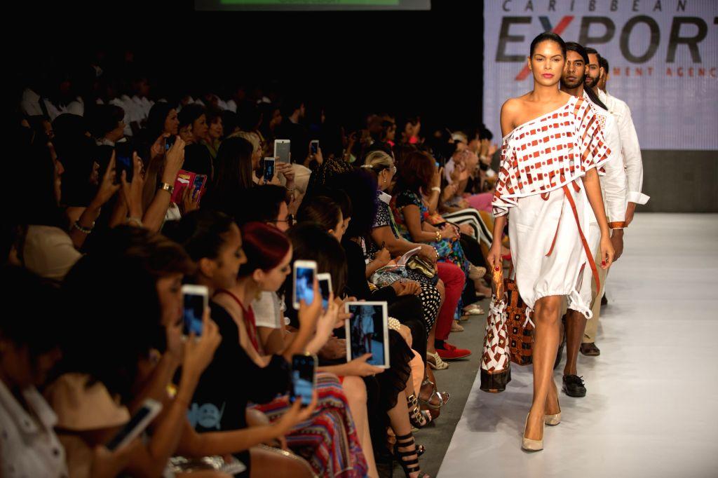 Models present creations of Haitian designer Miko Guillaume, during the fashion show Dominicana Moda 2015, in Santo Domingo, Dominican Republic, on Oct. 21, ...